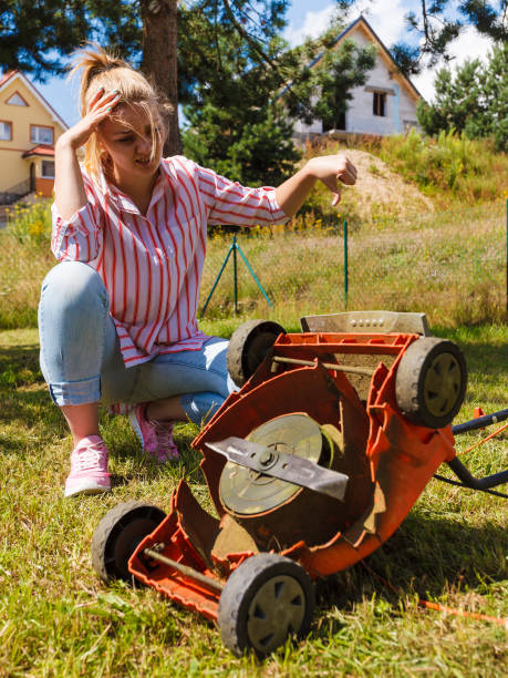 Woman With Lawn Mower On The Backyard Stock Photo - Image