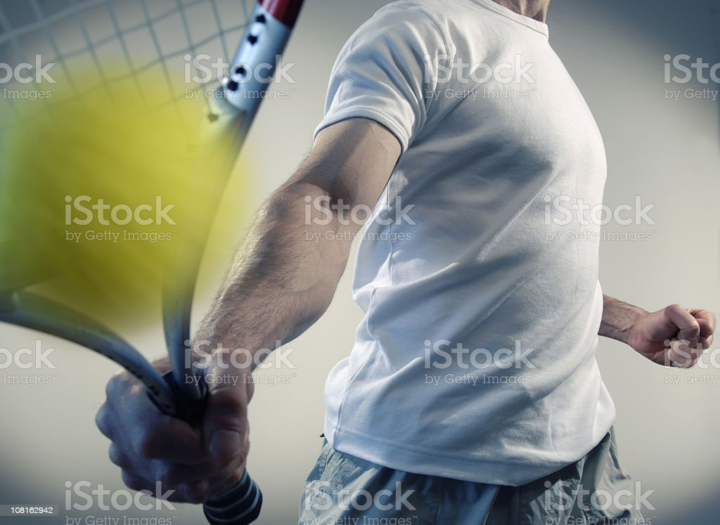 person hitting yellow ball with tennis racquet royalty-free stock photo