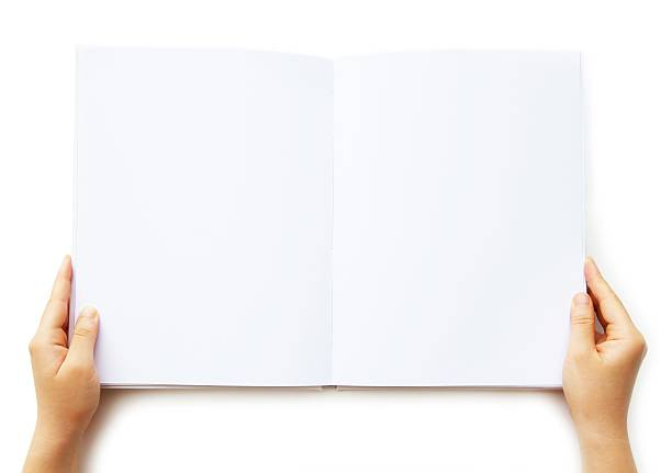 a person holding a blank book of paper  - smeren stockfoto's en -beelden