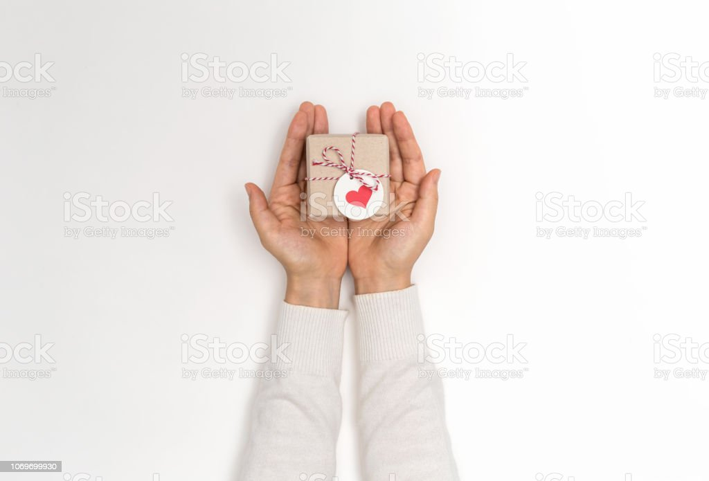 Person holding a Christmas gift box - Foto stock royalty-free di Amore
