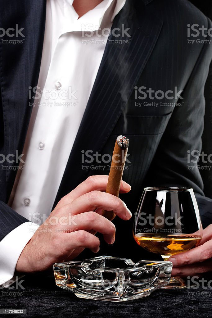 Person holding a cigar stock photo