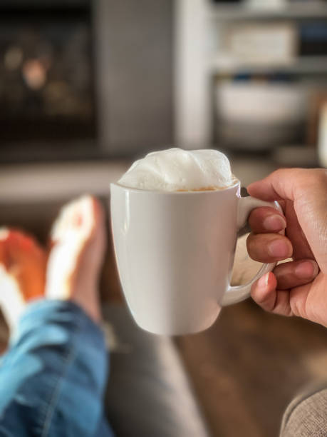 Person holding a cup of coffee stock photo