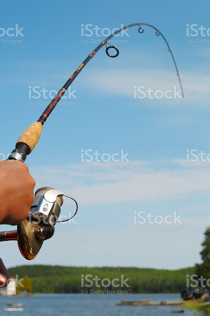 A person holding a fishing rod royalty-free stock photo