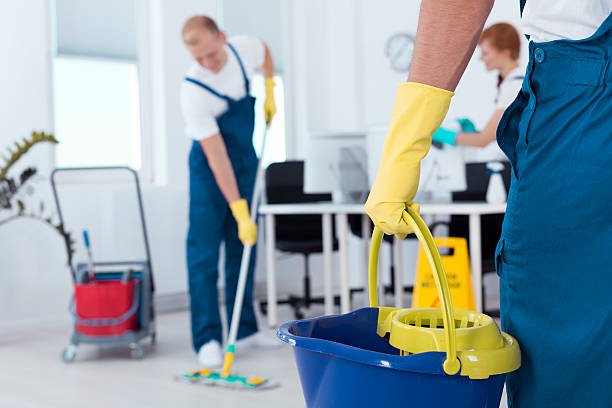 Person holding a mop pail stock photo