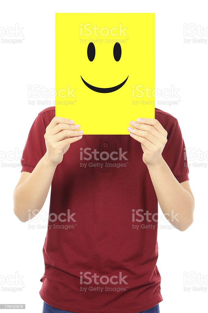 Person holding a picture of a yellow smiley face stock photo