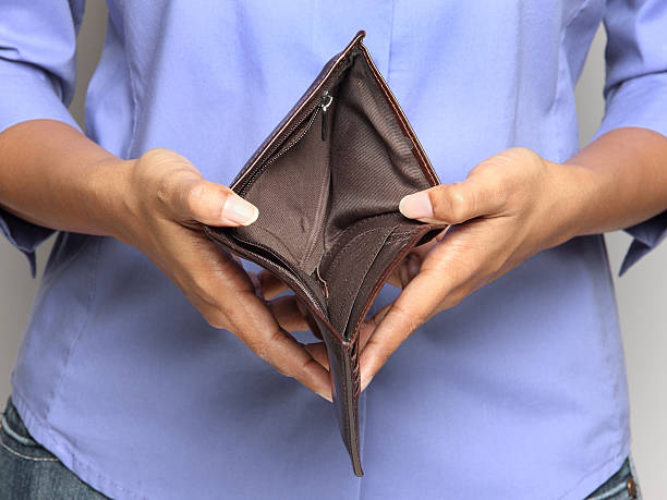 Person holding an empty wallet - showing bankruptcy stock photo