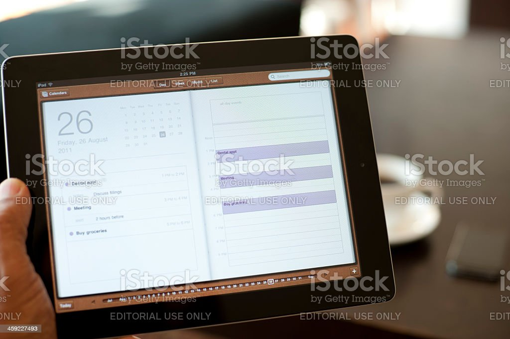 Person holding an ipad royalty-free stock photo