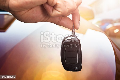 Close-up Of A Person's Hand Holding Car Key