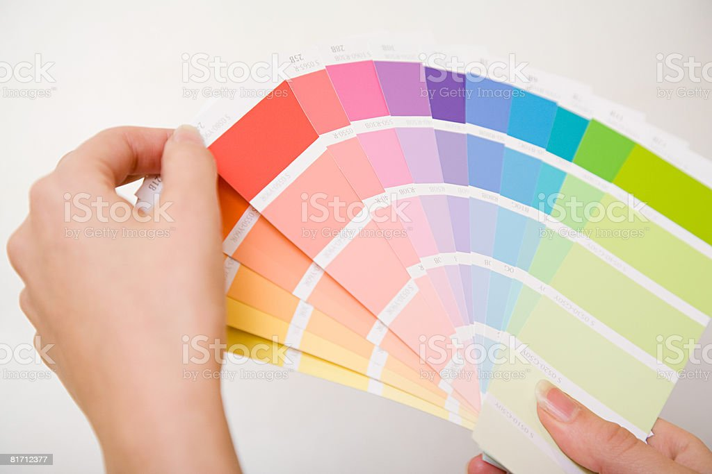 Person holding colour charts stock photo