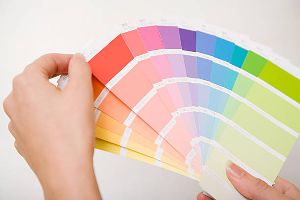 person holding colour charts - choosing stock photos and pictures