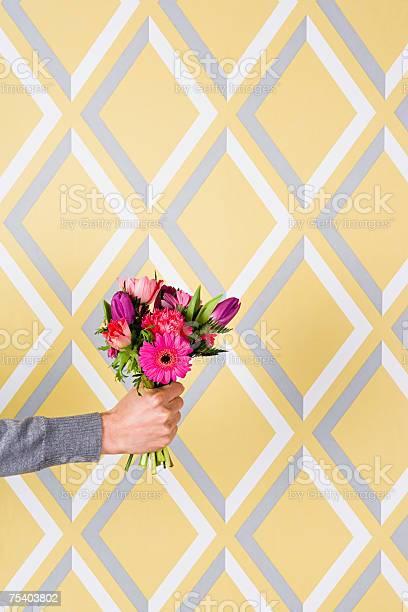 Person holding flowers picture id75403802?b=1&k=6&m=75403802&s=612x612&h=oibz5vih1jch nr5zjvphlqgcsfexgolruqfhzbytb8=