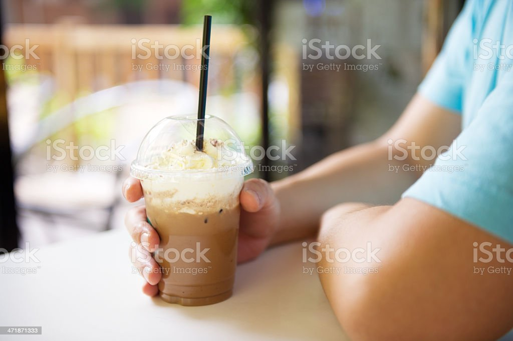 Person Holding Iced Coffee stock photo