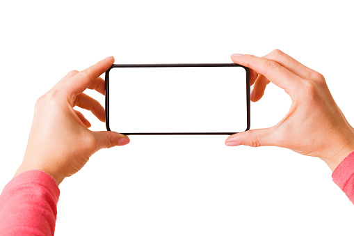 Person holding in hands smartphone with blank screen and taking picture or recording video, photo isolated on white background