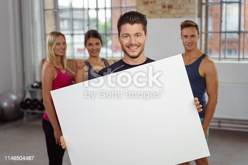 istock Person holding large blank white poster 1146504487