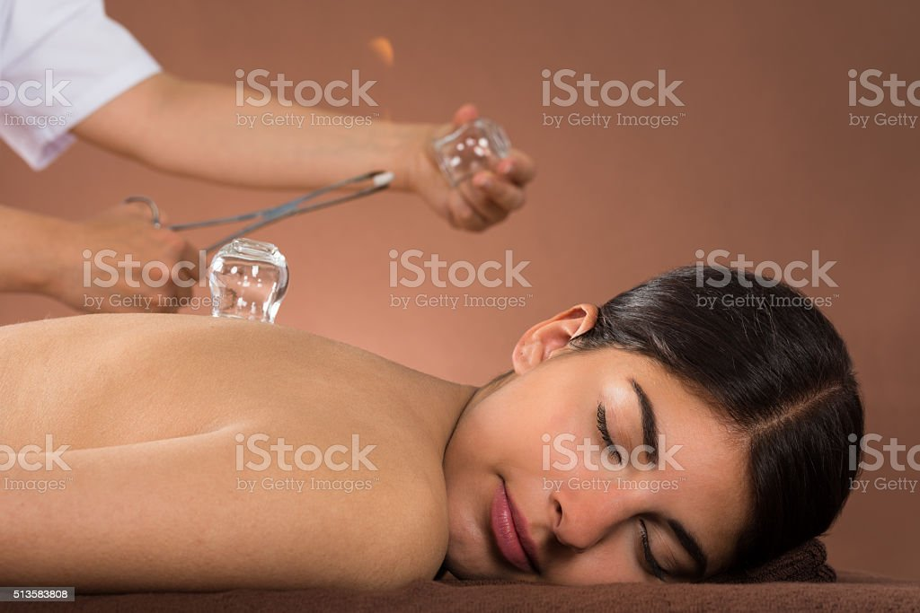 Person Holding Lit Camphor And Cup stock photo