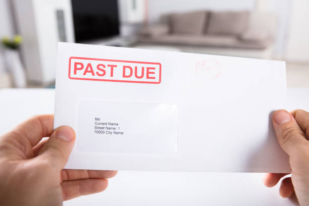 person holding past due bill envelope - collection stock pictures, royalty-free photos & images