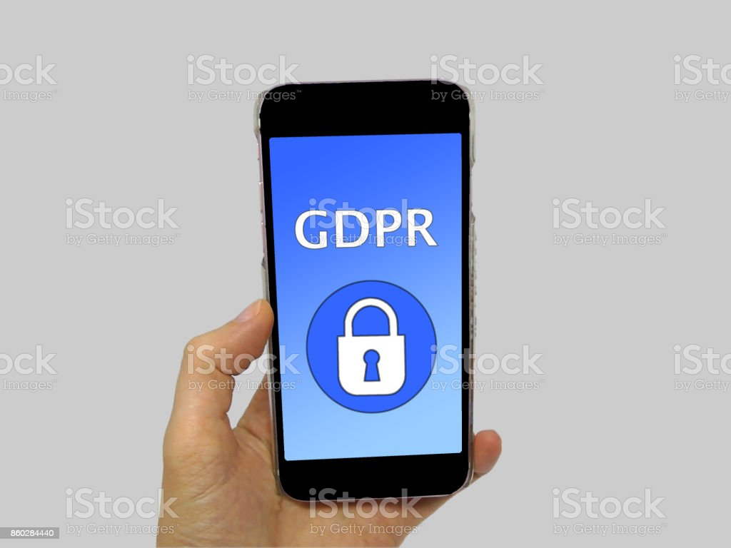 Person Holding Phone with General Data Protection Regulation (GDPR) on Screen - Data Protection Concept stock photo
