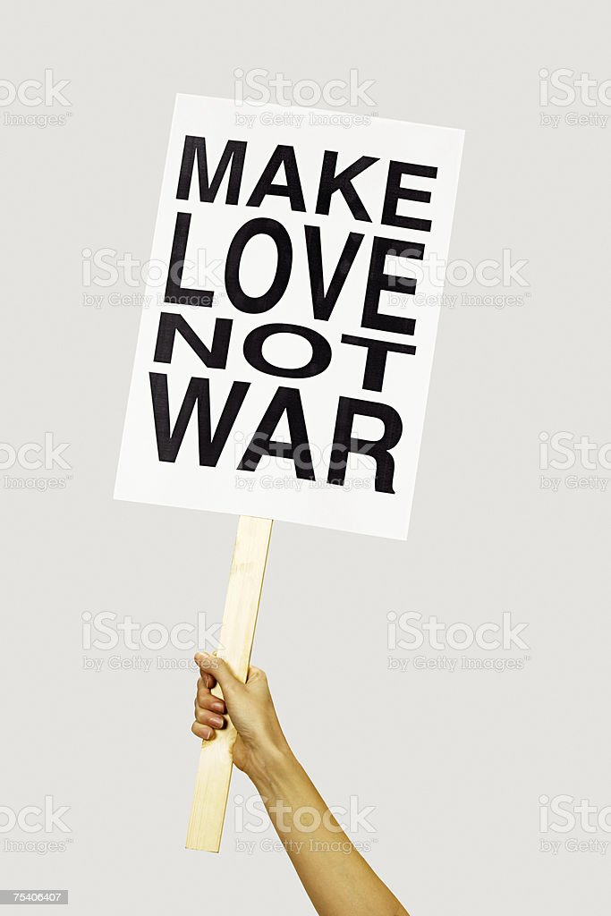 Person holding placard stock photo