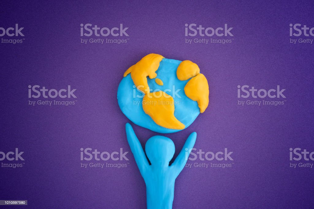 Person holding planet Earth - Royalty-free Adult Stock Photo