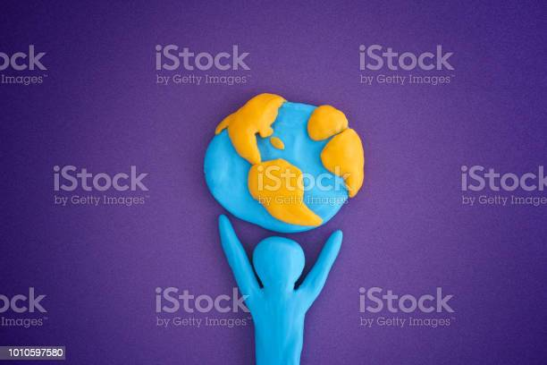 Person Holding Planet Earth Stock Photo - Download Image Now