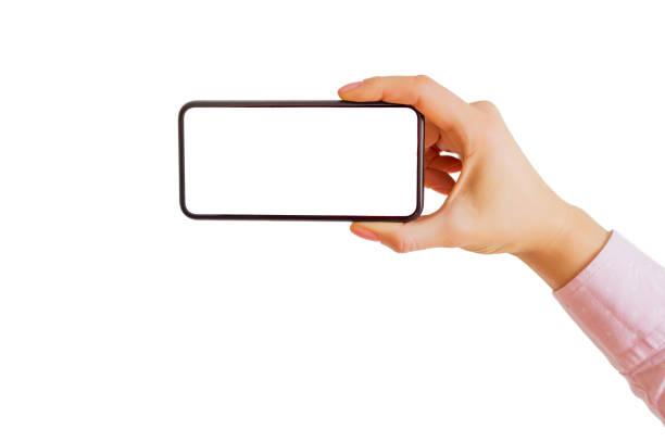 person mit smartphone horizontal in einer hand. mobile app-mock-up. - fotohandy stock-fotos und bilder