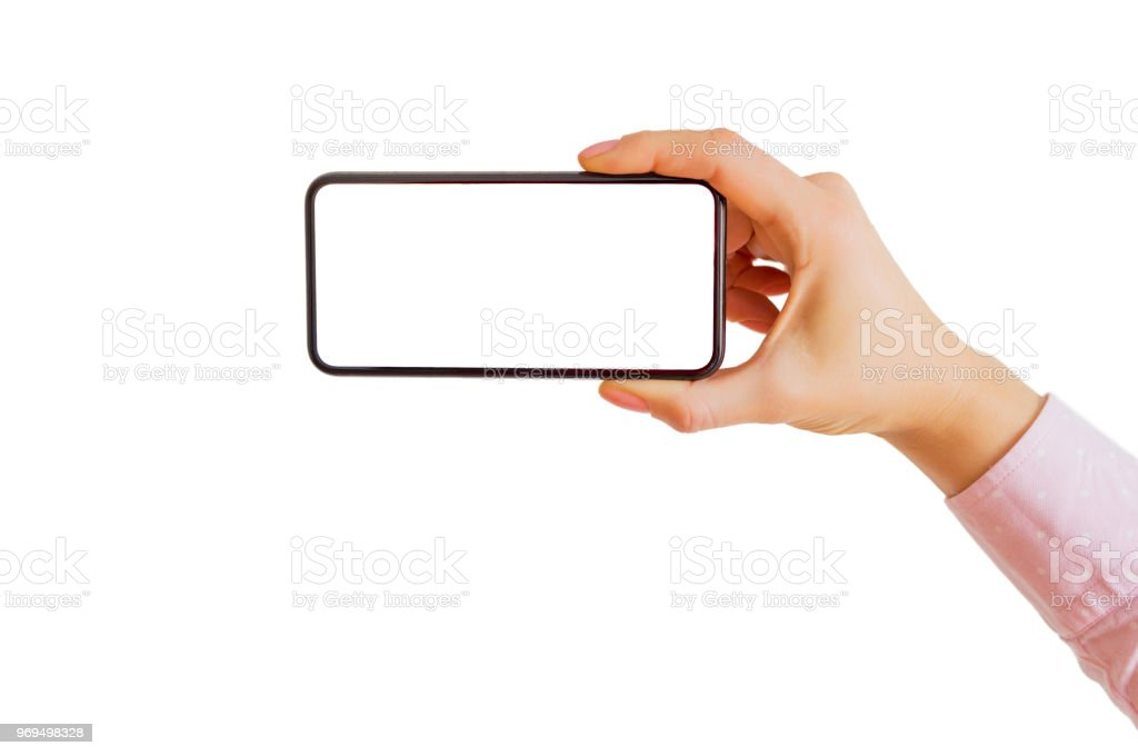 Person holding smartphone horizontally in one hand. Mobile app mockup. stock photo