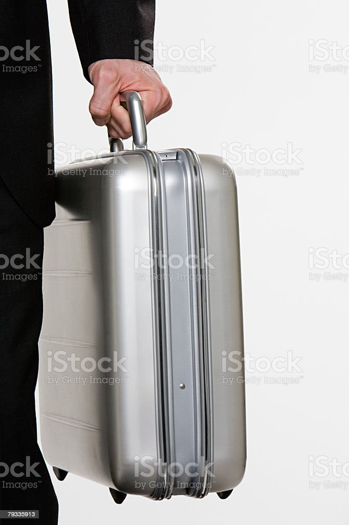 Person holding suitcase royalty-free 스톡 사진