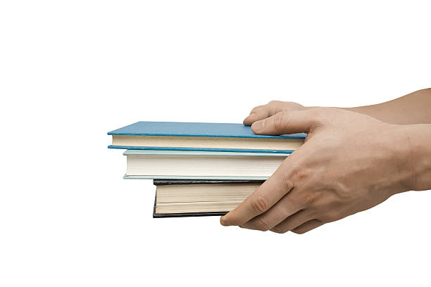 Person holding three hardcover books on a white background Two hands outstretched, isolated on white background. borrowing stock pictures, royalty-free photos & images