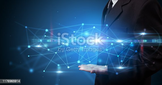 520592332istockphoto Person holding web hologram 1176965914