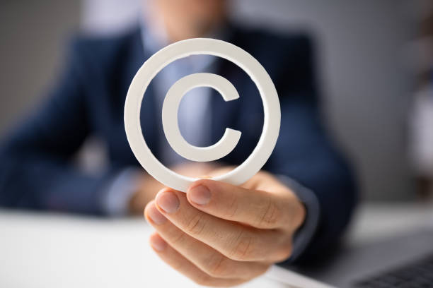 Person Holding White Copyright Sign stock photo