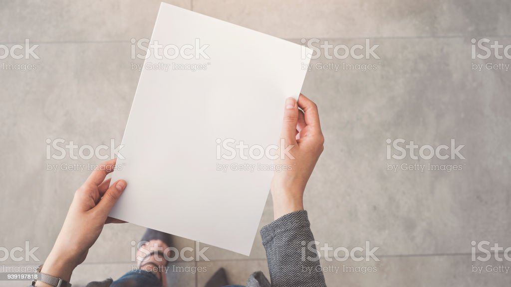 Person holding white empty paper royalty-free stock photo