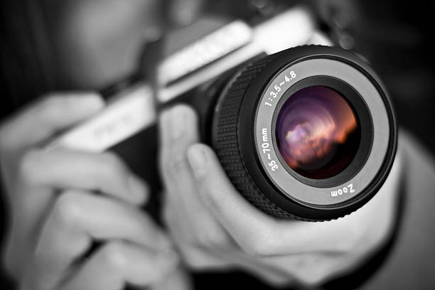 person holds camera - camera lens stock photos and pictures
