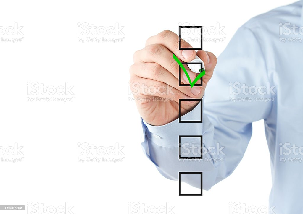 Person in blue shirt checking a list stock photo