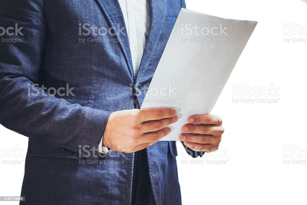 person in elegant business suit examining document stock photo
