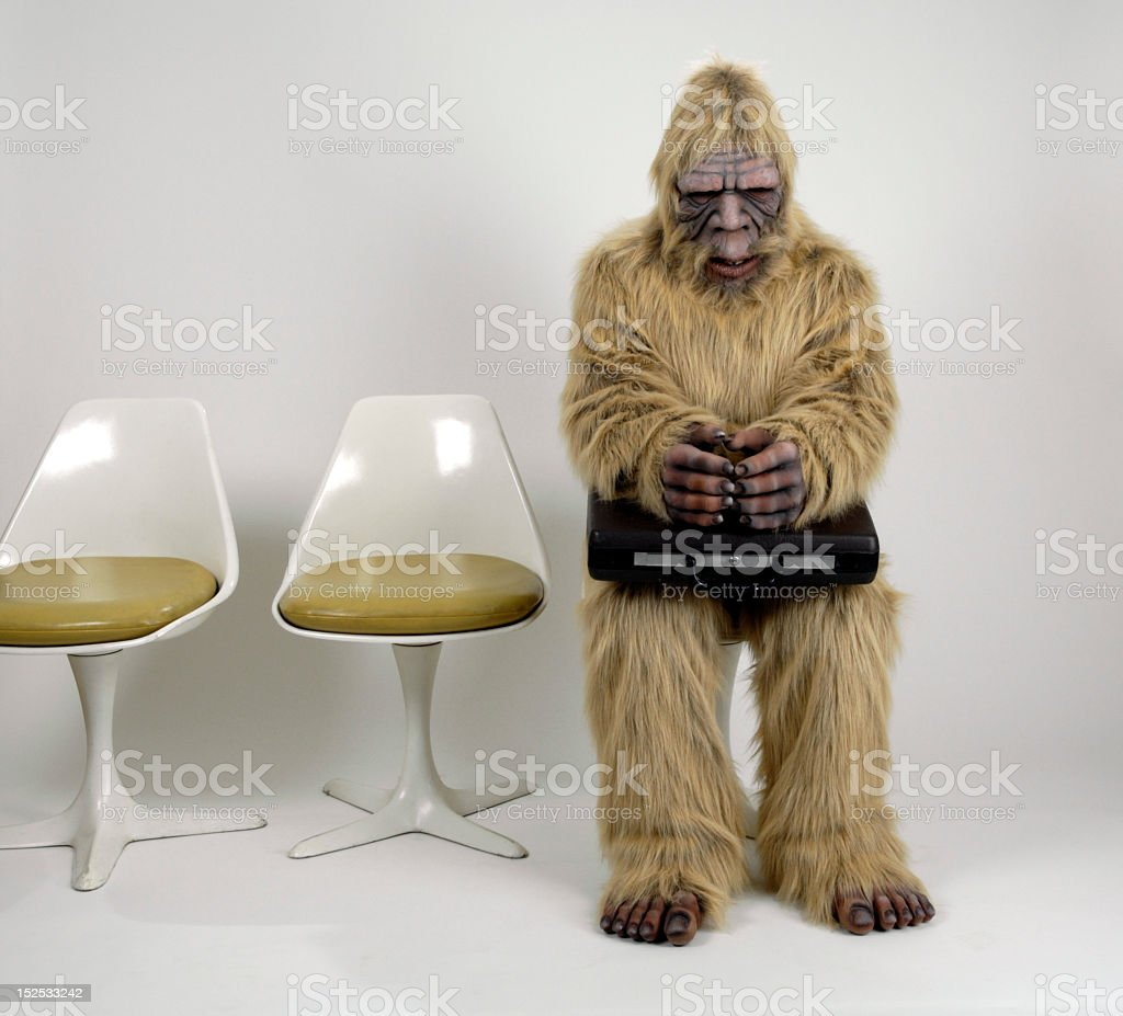 Person in full body costume waiting for an interview stock photo