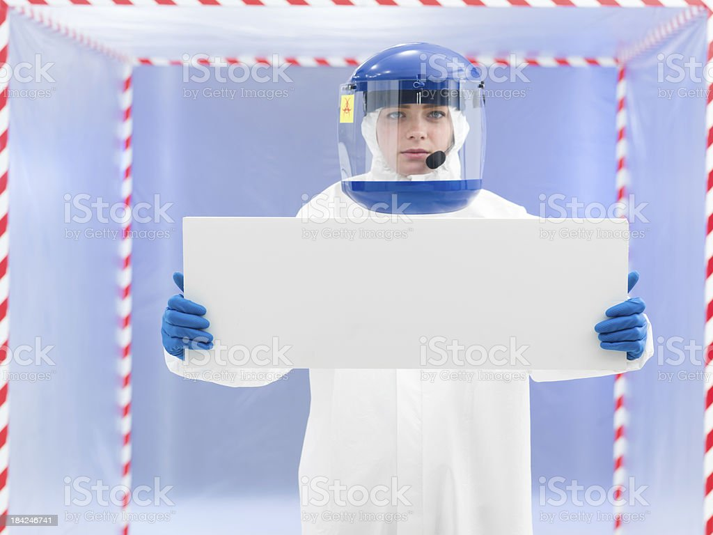 person in protective suit holding white board royalty-free stock photo
