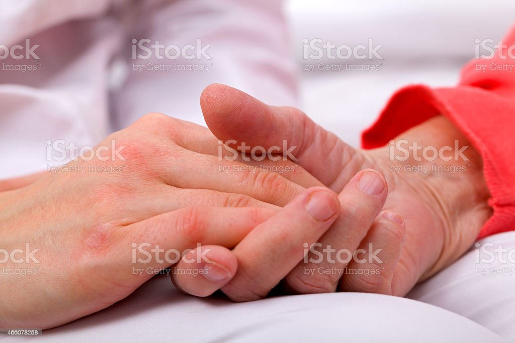 Person in red holding another person's hand over white royalty-free stock photo