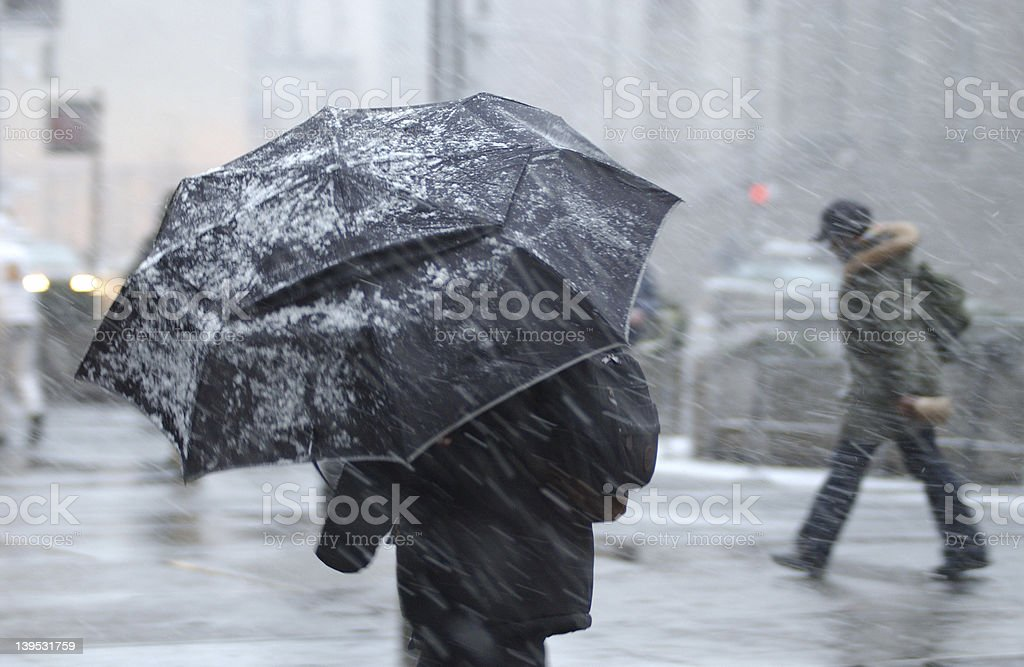 Person in Snow Storm stock photo
