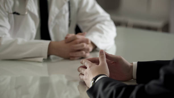 Person in suit at urologist appointment, private treatment of male diseases stock photo