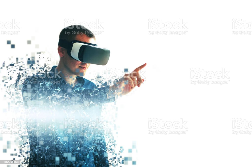 A person in virtual glasses flies to pixels. The man with glasses of virtual reality. Future technology concept. Modern imaging technology. Fragmented by pixels. stock photo
