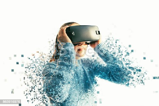 istock A person in virtual glasses flies to pixels. The woman with glasses of virtual reality. Future technology concept. Modern imaging technology. Fragmented by pixels. 865916976