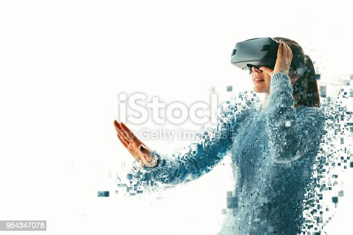 istock A person in virtual glasses flies to pixels. The woman with glasses of virtual reality. Future technology concept. Modern imaging technology. Fragmented by pixels. 954347078