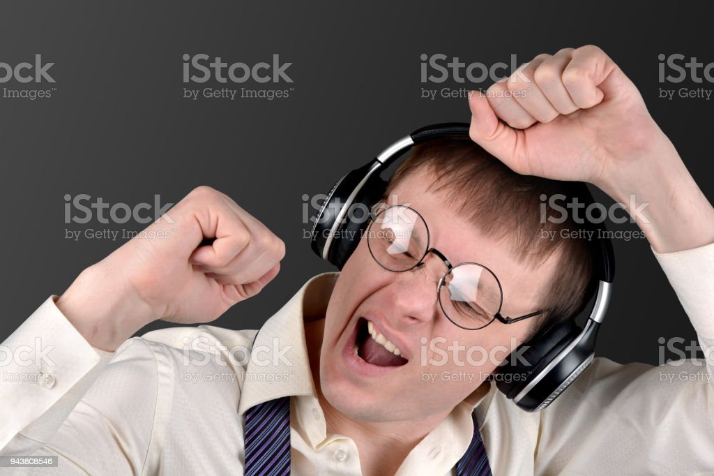 person is too emotional listening to music stock photo