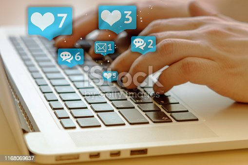 497982910 istock photo Person is using laptop with black keys, Social media and social networking. Marketing concept. Hearts and letterboxes with counters. Marketing and business concept. May be used for illustration. 1168069637