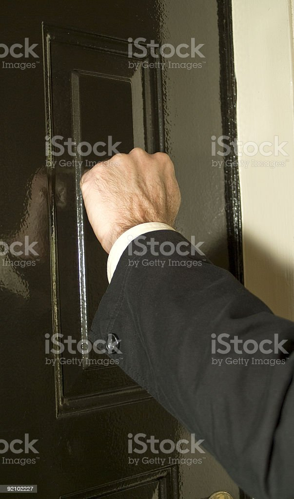 A person knocking on the door  stock photo