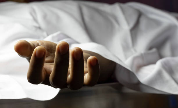 person laying dead with outstretched hand an Indian or Asian person laying dead with outstretched hand during COVID-19 or corona virus outbreak dead stock pictures, royalty-free photos & images