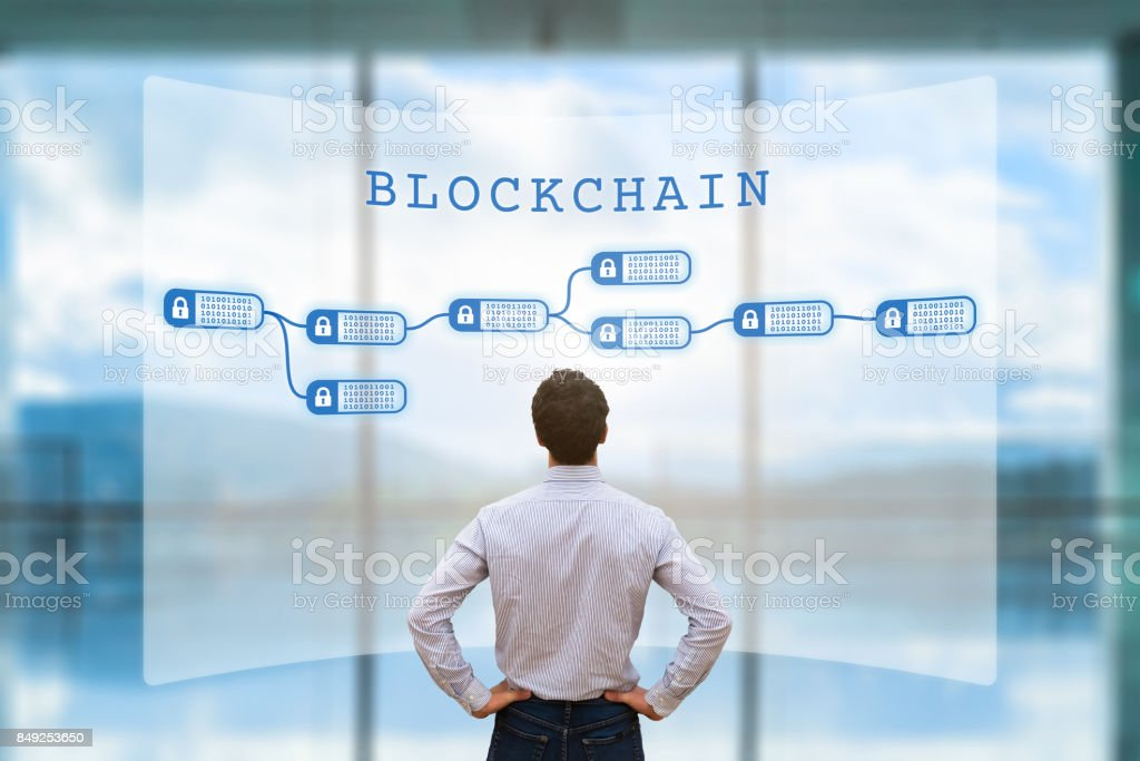 Person looking at blockchain concept on screen, cryptocurrency, business, fintech Person looking at blockchain concept on screen as a secured decentralized ledger for cryptocurrency financial technology and business transaction data, fintech Abstract Stock Photo