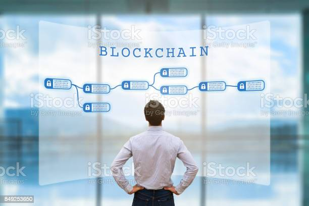 Person Looking At Blockchain Concept On Screen Cryptocurrency Business Fintech Stock Photo - Download Image Now
