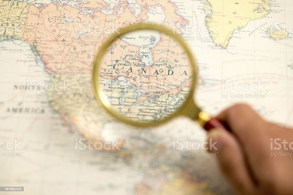 Person Looking at Canada Map stock photo