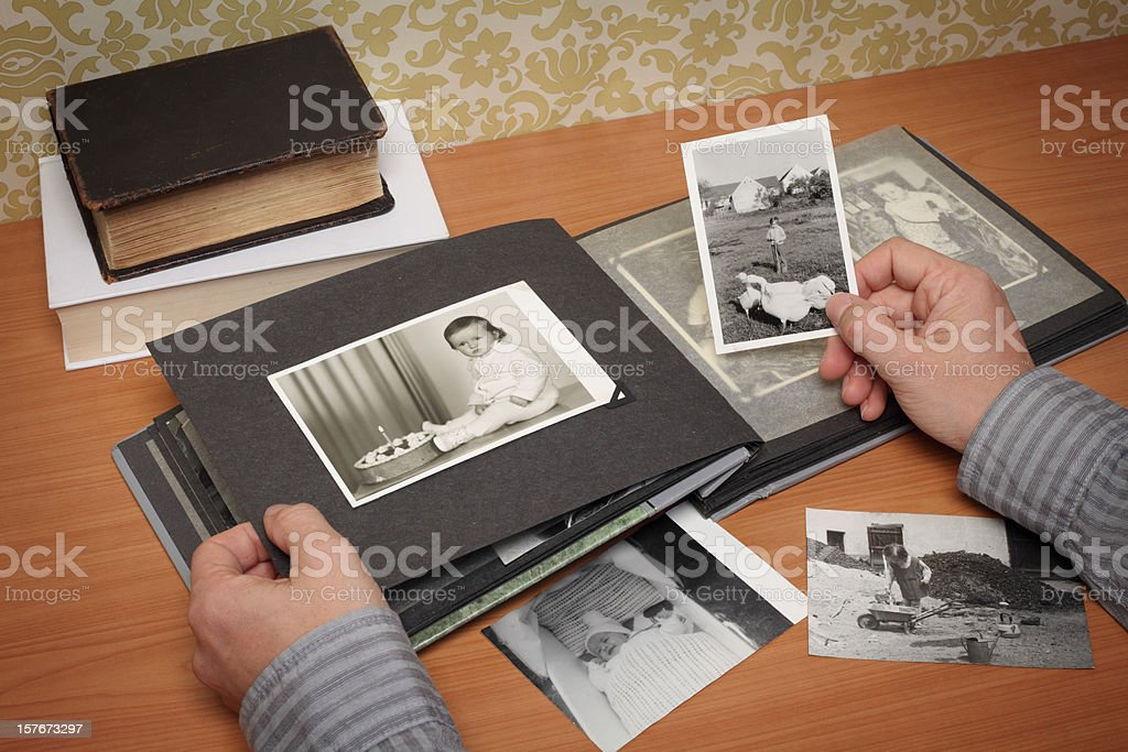 Person Looking at the Album with Old Photographs royalty-free stock photo